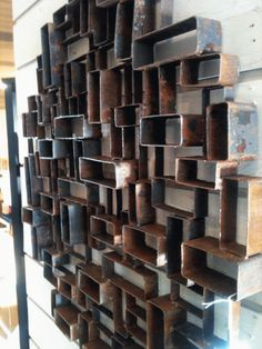 Really awesome rusted metal wall art. Simple thin wall box tube cut offs welded together. Wish it was rectangular...I would have bought it on the spot. Maybe I'll make my own.