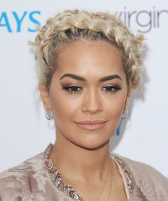Rita Ora Curly Braided Updo.  http://www.thehairstyler.com/hairstyles/casual/long/curly/rita-ora