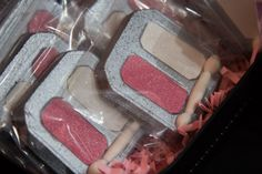 Glam fashion party favors.  Chocolate eyeshadow palette with icing sheet eyeshadow and fondant applicator.