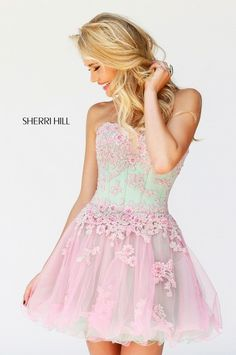 Short and sweet prom dress from Sherri Hill. Beautiful corset bodice with lace accents and full tulle skirt. Great for prom or homecoming. View Size Chart