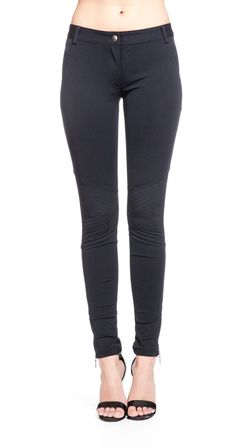 The Brooklyn pant by Nicole Miller is made of a nylon and spandex blend fabric that is ultra stretchy and makes it easy for you to move around. The Brooklyn New City pant has a hook and bar front closure with a traditional front zipper and seamed pockets. The slim fit style of this Nicole Miller pant is perfect for tucking into your favorite pair of boots or heels. Pair this figure-flattering Brooklyn New City pant by Nicole Miller with a loose silk top to create the perfect outfit.