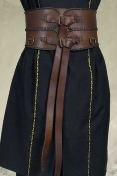 Double buckle wide band brown leather belt Check out our Collection of Belts.