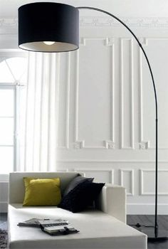 """A nod to the traditional in a modern setting with the wall mouldings.  A simple repetitive pattern all in the same color keeps a modern interior from feeling too cold.  Also, larger rectangles can """"frame"""" art work."""