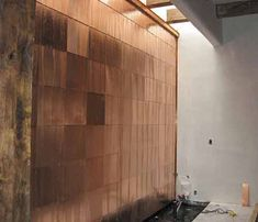 Lustre Tile Wallpaper Metallic gold tile wall paper with oxidized copper patina introducing