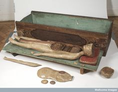 A German wooden anatomical figure with removable parts together with a rather coffin-like box, c. 1700