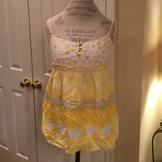 Juicy Couture yellow tank Beautiful  juicy couture yellow tank! It has adjustable straps and is in like new condition. Only worn a couple times! (Needs to be ironed!) :) Juicy Couture Tops Tank Tops
