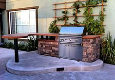 barbeque with a build in wooden table top.