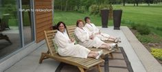 Three women enjoy a glass of wine at Evensong Spa, while enjoying the views of Tuscumbia golf course.