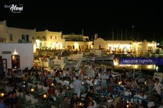 The famous nightlife at the traditional fishing port of Naoussa, Paros, Cyclades. Naoussa Paros, Paros Greece, Paros Island, Places In Greece, Cool Bars, Nightlife Travel, Greek Islands, Summer Nights, Cafes