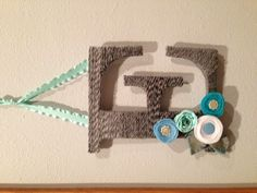 Yarn wrapped letter with ribbon