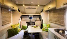 This caravan space is a good example of how to use a small space for dual purposes. It also gives a good idea for how versatile shelving can be.