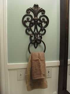 wrought iron flower pot holder as towel ring...love this!