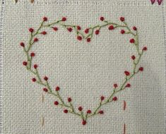 Great Embroidery Site! ~ Heart made of Feather stitch and Colonial Knot