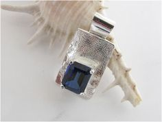 Emerald cut sapphire on textured sterling - what a glorious gift. From SterlingByDix on ArtYah.