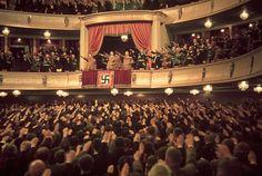 Adolf Hitler and Joseph Goebbels (in box) at Charlottenburg Theatre, Berlin, 1939.