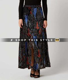 Style OB545544/Sku 801495; Lined button front 41' maxi skirt; Side zip and hook and eye details; 22 1/2' front vent; Shell: 100% Rayon. Lining: 100% Cotton.; Hand wash cold separately. Do not wring or twist. Use only non-chlorine bleach. Line dry. Low iron as needed. May be dry cleaned. #FreePeople #Skirts #Black Combo
