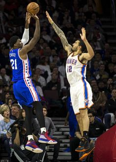 Philadelphia 76ers' Joel Embiid, left, puts up the shot with Oklahoma City Thunder's Steven Adams, right, defending during the first half of an NBA basketball game, Wednesday, Oct. 26, 2016, in Philadelphia. (AP Photo/Chris Szagola)
