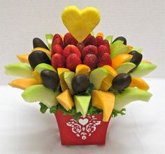 Create your own Edible Arrangments for Mother's Day. A parring knife, some shish kabob sticks, and a base (I've tried using cabbage for an edible base). Enjoy RainbowFoods.