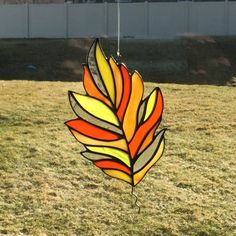 This beautiful stained glass oak leaf suncatcher is made of hand cut glass in fall colors. The pieces are individually wrapped in copper foil, and soldered. I then used a black patina on the solder and stem to really make the autumn colors pop. It is waxed and buffed to shine. It comes ready to hang with a sturdy hook and clear line. The leaf measures approximately 5 1/2 x 3 5/8 inches at longest points (each varies slightly as they are all hand made). Copper tinned wire is used for...