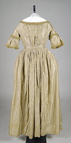 Figured gold silk evening dress with ruffled lace trim, American, ca. 1848.