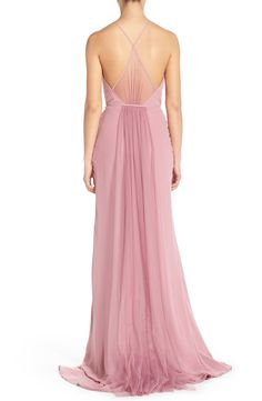 Free shipping and returns on Monique Lhuillier Bridesmaids Chiffon & Tulle Halter Gown at Nordstrom.com. A lushly gathered panel of airy tulle that falls from the high halter neckline to the floor-sweeping skirt lends soft-focus romance to the front of a dreamy chiffon column gown. Piping accentuates a slender waist and cutaway shoulders put the spotlight on glowing skin.