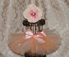 Peaches 'n Cream Newborn SEWN Tutu with matching pearl center flower. $35.00, via Etsy.