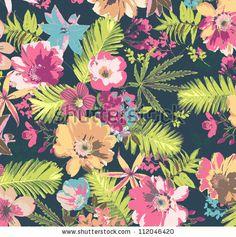 tropical flower pattern on blue background by SalomeNJ, via ShutterStock