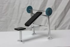 A scale miniature Weights bench. Perfect for any home fitness or gym scene.