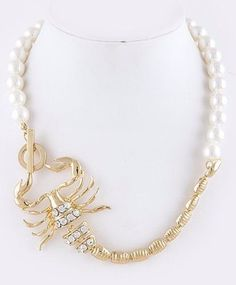 "Scorpion Necklace Retail $49 HOW FUN!!! Faux pearl adorned with a crystal embedded scorpion. Lariat style closure. 21"" long. Please check my store for many more items including designer clothing, shoe"