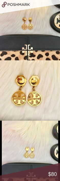"""Authentic Tory Burch Drop double T gold earrings Tory Burch Circle Logo Earring is a shining example of effortless chic. It combines a hexagonal stud with her iconic double-T - putting a subtle geometric spin on a classic look. More substantial than a button style, yet still understated, this dangling accessory is perfect for the everyday. Made for pierced ears. 1 1/2"""" Condition: Gently Used. See pics for scratches. I do not have the original backs, they would not stay on when wearing and…"""