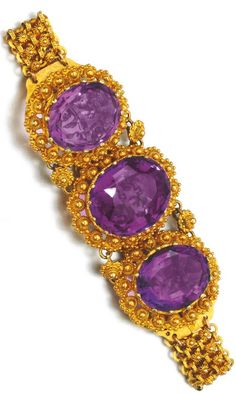 PAIR OF GOLD AND AMETHYST BRACELETS, EARLY 19TH CENTURY Each set with three oval amethysts within cannetille work borders, to a chain of cannetille work linking, each length approximately 175mm.