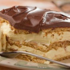 Eclaire Torte:  Line 9x13 pan with graham crackers, mix 2 pkgs vanilla pudding, 3 cups milk, and one cream cheese together until smooth.  Spread half over graham crackers.  repeat with graham crackers on top.  Melt one ready to frost fudge frosting in microwave and spread on top.  Let stand in fridge overnight (at least 12 hours).  Delicious!  A favorite pot luck recipe.  Enjoy!!!