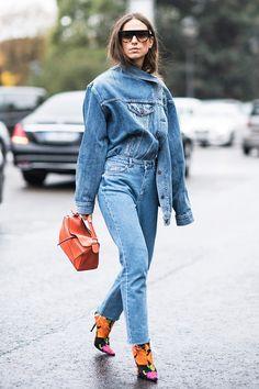 paris fashion week street style spring 2018 erika boldrin denim jacket jeans orange loewe bag balenciaga floral print boots getty images