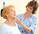 Strengthen Your Neck Muscles: Do cervical retraction by bringing your head back and up, the way the nurse's hand is guiding the woman's chin in this photo.