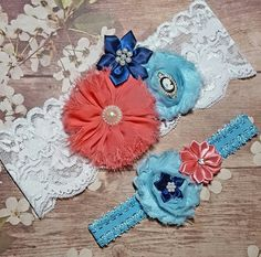 Check out this item in my Etsy shop https://www.etsy.com/listing/468555532/coral-navy-and-light-blue-wedding-garter