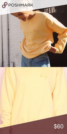 """NWT Brandy Erica Honey Sweatshirt Relaxed fit blended cotton pullover sweatshirt in yellow with a crewneck front and gold Honey embroidery on the left chest. Size small. Small washable mark-pictured in lastnpic.   Measurements: 26"""" length, 20"""" bust Brandy Melville Tops Sweatshirts & Hoodies"""