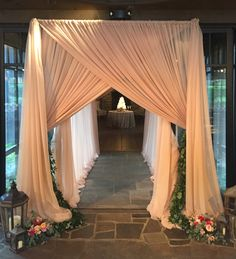 What an entrance! This gorgeous blush nude draped entrance is elegant and transforms the space. Seen here at the Farm at Old Edwards Inn. #eventdraping #blushnudedraping #entrydraping