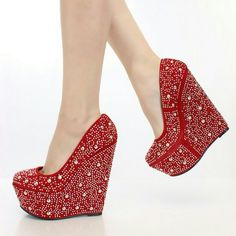 4 @hollylynn8 HP 11-29-15 Red wedges shoes. Make sure to add these to your collection, they definitely are a must have! Featuring faux suede upper with a scoop vamp, round toe, rhinestone and studded decor, smooth lining, and cushioned footbed. Approximately 6 inch wedge heels and 1 3/4 inch platforms.   Selling this bc it's 2 tall 4 me... nwot Doesn't come with box.. Shoes