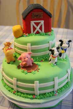 The animals are toys, but the remainder of the decorations are MMF.  The barn and hay bale are rice krispy treats.  Thank you to all of you who have posted other farm cakes for the inspiration!