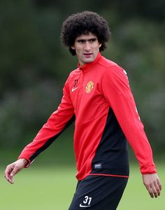 "Marouane Fellaini of Belgium with the ""broccoli."" 