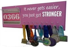 It never gets easier you just get STRONGER - Race bibs and medal hanger - $39.99 - Available in 20 colors.