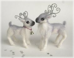 Reindeer Wedding Cake Topper for Winter Weddings.    A little Wintery whimsy for your special day. This lovely little doe and stag are needle felted from white and silver grey merino wool, with the teeniest bit of sparkly angelica fibre for a magical finish. They have wire armatures inside, so can be gently coaxed into various poses so that they stand perfectly on top of a wedding cake with their tiny polymer clay hooves. Their antlers are wire wrapped in lovely metallic silver thread, if…