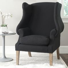 The timeless beauty of the 19th century wing chair is celebrated in the elegant Kameron wing back chair. Updated with a crisp black linen and brass nail head trim, Kameron assumes a transitional air with curvaceous wings and distressed oak wood legs. Truly transitional, this comfy wingback chair complements traditional, country and eclectic decorating styles.