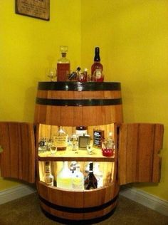 Small corner bar made from a Jack Daniels barrel. Complete with fridge