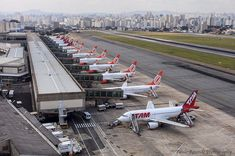 Congonhas Airport CGH (SBSP) dominated by local carriers TAM (red jets) & Gol (orange jets), engulfed by the city of São Paulo, Brazil.