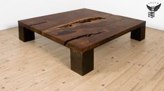 UHURU KONG COFFEE TABLE // Shown in locally milled claro walnut with blackened steel base, 53x53x14H, 2008 // DESCRIPTION: The Kong Coffee table is created from a one-of-a-kind hardwood slab set on a frame of four 7″ x 7″ steel boxes with a blackened or powder coated finish. Contact us for options. // uhurudesign.com