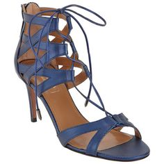 These are a statement piece, just the same as a bold necklace. The key is to balance these sexy detailed heels with a crisp monochromatic ensemble.   I love mixing blues, so you can pair these with navy or light blue. They will also look fabulous with a white or beige ensemble. I recommend light pink or fuchsia pink toes.   Evaluate.Shop.Style. www.ChristinaStyles.com  Aquazzura Beverly Hills 75 Sandal at Barneys.com
