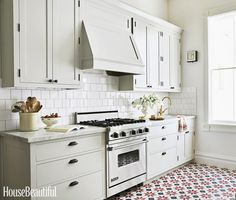 white kitchen cabinets, white subway tile, maybe a bit too much white! but I like the the cabinets