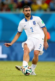 Giannis Maniatis of Greece in action during the 2014 FIFA World Cup Brazil Group C match between Japan and Greece at Estadio das Dunas on June 2014 in Natal, Brazil. Get premium, high resolution news photos at Getty Images Fifa World Cup, Soccer, Action, Football, Sports, Legends, Fan, News, People