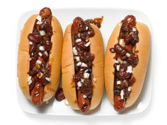 Barbecue Bean Chili Dogs are the perfect way to celebrate National Hot Dog Day today. Find your favorite combination in #GrillingCentral.